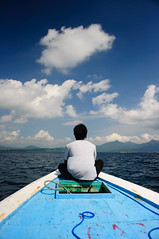 The man on the boat (Fajar Nurdiansyah) Tags: ocean bali cloud indonesia boat cpl nusamenjangan