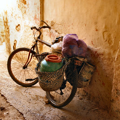 the bike........ (atsjebosma) Tags: light bike bicycle wall colours decay textures morocco maroc safi oldstreet oldcity fiets 2010 muur fietstas straatje atsjebosma