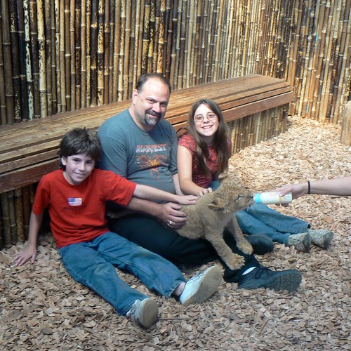 Gage, Greg, & Ruth with baby lion