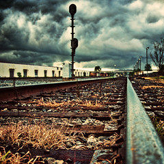 Ominous... (eRachel11) Tags: railroad train nikon dof rails rainstorm traintrack stormyweather wormseyeview rainraingoaway d90 topazadjust wormseyeviewsunday astormisrollingin thankfullynoonesawmepracticallylayingonthetraintrackstheymighthavequestionedmysanity