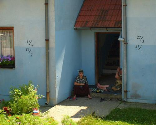 Refugee women under the shade