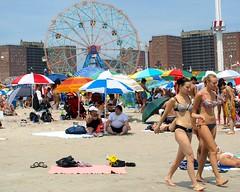 Coney Island Beach, New York City (jag9889) Tags: ocean park county street city nyc summer people ny newyork beach brooklyn coneyisland amusement sand crowd scene atlantic kings boardwalk umbrellas sunbathing wonderwheel 2010 y2010 jag9889
