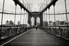Brooklyn Bridge Runner (Tapachu) Tags: blackandwhite bw newyork skyline nikon brooklynbridge lightroom nikond200 nikkor1735mm