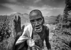 Tulgit village old Surma woman - Ethiopia (Eric Lafforgue) Tags: old woman girl dof village hand ride artistic main 28mm salute bodylanguage hasselblad ornament clay lip bodypainting rite surma bodymodification tribo vieille labret adornment pigments omo eastafrica thiopien suri etiopia ethiopie etiopa h3d 897  etiopija ethiopi  lipplug etiopien etipia  etiyopya  nomadicpeople      tulgit    turgit peoplesoftheomovalley lipdisclipplate piercedhole piercedlipornament