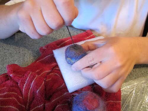 Hot Rod needle felting onto his felt ball