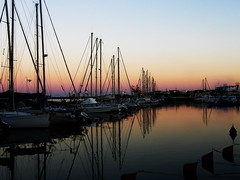 Marina Dusk (Annie in Beziers) Tags: sunset sea summer sky france beach water reflections boats sailing sundown dusk explore yachts nautical masts buoys moorings moored valrasplage buoyant ginpalaces annieinbziers