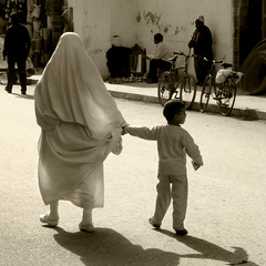 mother and child (R. O. Flinn) Tags: street sepia child mother hijab morocco essaouira islamic khimar