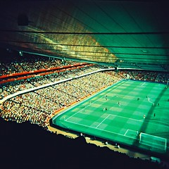 Arsenal vs AC Milan (slimmer_jimmer) Tags: football holga xpro crossprocessed stadium 120film crossprocessing vignette arsenal emiratesstadium kodakektachromee100g e100g emiratescup