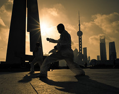 tai chi on the bund (samthe8th) Tags: morning silhouette prime star shanghai sam explore 20mm frontpage taichi bund f28 starburst d700 flickrchallengewinner thepinnaclehof taichionthebund tphofweek61