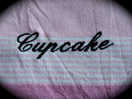 Cook a cupcake. A decorative tea towel.