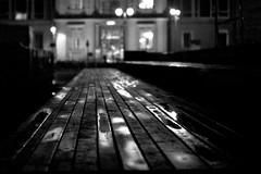 boardwalk to the staatsratsgebaude (Winfried Veil) Tags: leica wood blackandwhite bw berlin water lines night germany deutschland 50mm vanishingpoint wasser dof veil nightshot nacht bokeh perspective rangefinder depthoffield sw schwarzweiss holz reflexion spiegelung summilux asph winfried perspektive 2010 nachtaufnahme refleciton m9 bwblackandwhite mirroring flucht linien holzsteg schwarzweis iso640 messsucher pfutze mobilew leicam9 temporarekunsthalle winfriedveil scharfentiefe tiefenscharfe unscharfe