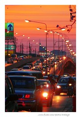 Walking Along (Araleya) Tags: road street city light sunset red urban orange car thailand evening twilight colorful southeastasia chaos traffic bangkok citylife poetic stop trafficjam flyover congestion chaotic nonthaburi  araleya   captical chaengwattanaroad totallythailand