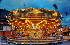 Time spins fast (Jacquie Akroyd) Tags: uk light sea horses copyright night photography amusement town seaside nikon photographer harbour painted yorkshire carousel fair front east amusements bridlington d60 rattesalat jacquiegibson jacquiegibsonphotography jacquieakroydphotography jacquieakroyd