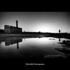 The standing reflection (Feo David) Tags: ocean africa woman lighthouse reflection standing canon eos morocco maroc marocco 5d phare rabat