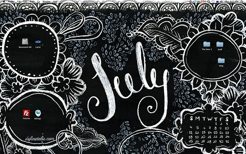 Computer wallpaper for July featuring black background and white and light blue doodling as well as places to put your icons.