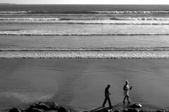 Memories (Gaz-zee-boh) Tags: ireland sea bw white beach water monochrome walking seaside sand couple romance atlantic blackand lahinch coclare seawater thewest seasidetown 5photosaday almostanything liscannorbay