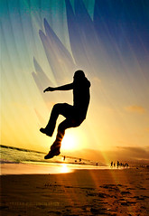 Free Fallin' (Emmanuel_D.Photography) Tags: california sunset beach leaves silhouette yellow sunrise canon pier losangeles cool santamonica awesome free coolness astig fallin 50d 1740mmf4l