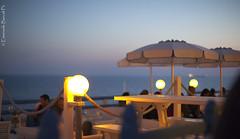 Calafuria (Emanuele Barcali) Tags: light sunset happy tramonto hour pace ombrelloni livorno aperitivo calafuria