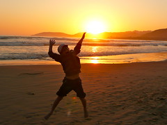 Reach for the Sun (Libra 42) Tags: ocean california light boy sunset summer vacation sky orange usa sun reflection beach water fun lumix sand waves hills panasonic ourdailytopic