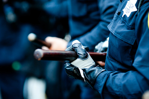 Oakland Riot Police Hold Baton, Oakland Riots, 2010