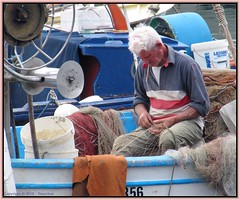 Naples  :  Fisherman's hands  - 1/3 (Pantchoa) Tags: voyage italy port canon geotagged italia travail vista napoli naples bateau filet pcheur turismo italie pescador npoles tourisme pescatore neapel  pche visitar  mergellina visiter  npols  filetdepche sannazzaro      canonpowershotsx200is powershotsx200is npolitourism