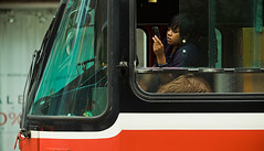 eyes on the prize (tomms) Tags: street toronto ttc cellphone tram transit driver streetcar