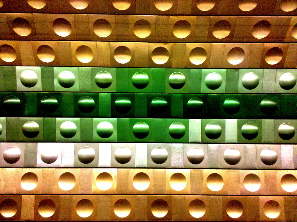 Gold, green, and silver wall with large concave circles