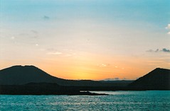 The Galpagos Islands (PeterWard78) Tags: sunset sea sky orange mountains southamerica ecuador thegalpagosislands