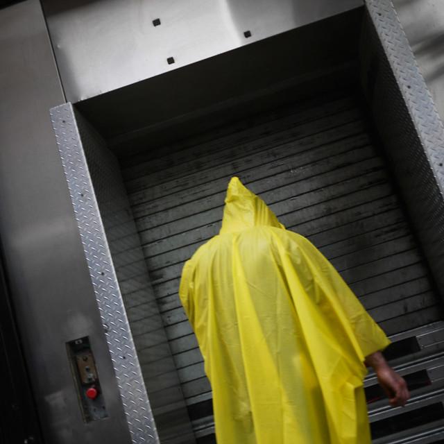 Guy in Yellow Rain Bag #walkingtoworktoday