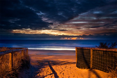 (Pawel Papis Photography) Tags: ocean morning blue sea sky cloud sun seascape beach water beauty grass clouds sunrise reflections landscape dawn sand paradise raw shadows peaceful wave australia calm explore simplicity queensland rails surfers frontpage dri surfersparadise handrails goldcoast pawel sigma1020 beachentry canon400d