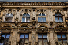 Lodz windows 16 (the aliens) Tags: old city windows house building window town balcony poland stucco dilapidated wartime lodz disrepair tamron1750 nikond90 1125secatf80