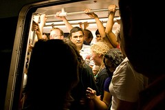 passengers crowd the Metro doors (by: Rik Koenig, creative commons license)