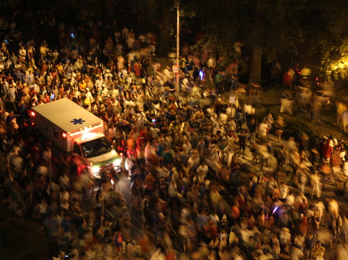 ambulance drowning among a sea of people