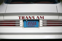 white trans am (Studiobaker) Tags: show blue red white classic window car wisconsin back am wings automobile shiny shine curves letters rear wheels smooth plate curvy licenseplate clean deck bumper license font trunk vehicle pontiac script trans curve wi transam taillights collector spoiler spotless louvers studiobaker 145504