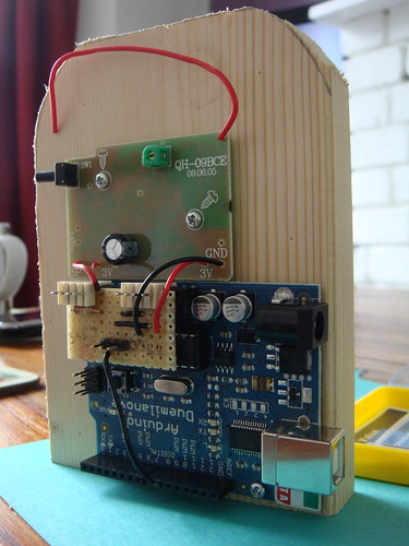 Arduino and doorbell mounted on wood block