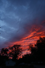 Hot and cold (A bunch of beans) Tags: blue sunset red sky storm silhouette clouds fire nebraska bright vivid brilliant redsunatnight