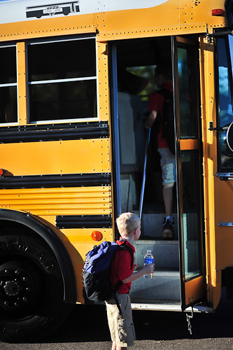 Child getting on School Bus