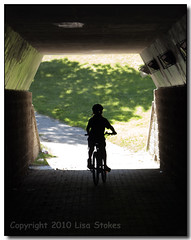 Into The Light (Lisa-S) Tags: boy shadow portrait ontario canada bike bicycle silhouette kids cycling lisas tunnel brampton alun 50d 9884 copyright2010lisastokes gappool