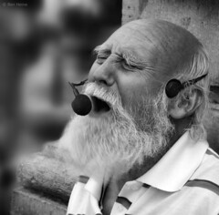 Papy Blues - 1 (Ben Heine) Tags: street camera brussels wallpaper portrait blackandwhite copyright music blur art monochrome closeup architecture composition mouth print lens beard photography lights freedom moving eyes focus artist dof belgium emotion pov expression lumière modernart space air performance arts creative blues voice oldman mature age liberté soul micro statement conceptual breathe author society tones songs speak connection struggle rockandroll barbe musique survive chanteur cs4 vrijheid youtube âme streetsinger interprète livingmonument mywinners benheine flickrunited samsungnx10 infotheartisterycom papyblues