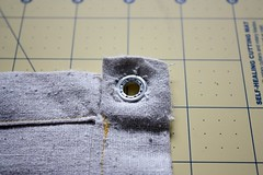 Step 7: Attach Eyelets According to Directions