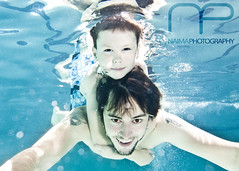 Uncle and Nephew (lindseynaima) Tags: family blue reflection water pool tattoo swimming fun happy aiden kid underwater child uncle floating bubbles swimmingpool nephew ikelite troyelizares littleonesswim lindseyhemphill naimaphotography