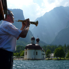Captains flugelhorn is echoed back from rocky Knigssee mountains (Bn) Tags: lake germany bavaria berchtesgaden topf50 echo kings captain fjord hikers sailor paragliding thealps bluelake paragliders flugelhorn cleanwater knigssee southgermany berchtesgadenerland 50faves nationalparkberchtesgaden berchtesgadennationalpark germanbavarianalps schnauamknigssee berchtesgadenalps stretchesabout77km formedbyglaciers nearborderwithaustria picturesquesetting sheerrockwalls royalmountainexperience cleanestlakegermany playflugelhorn steeplyrisingflanksmountainsup2700m hikingtrailssurroundingmountains mostbeautifulareaalps mostsmaragdcolouredlake mostknigssee superbecho