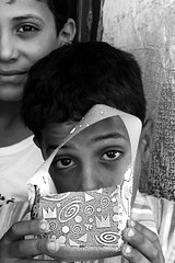A gift from Palestine (flatman.photography) Tags: monochrome face children happy photography israel kid eyes flickr peace sad emotion palestine westbank present violence idf refugeecamp flatman palestinianchildren balatarefugeecampchildren westbanksecurity flatmanphotography