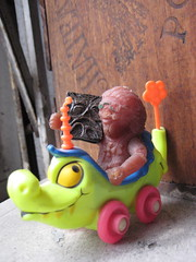Purple Rubber Hippie and Evil Book Necronomicon 2158 (Brechtbug) Tags: two elephant flower face car female wagon toy toys book driving dragon with purple alligator hippy evil rubber crocodile hippie around 1960s horn 1970s trippy unicorn groovy mattel playset wagons psychodelic necronomicon janus jigglers jiggler upsydownsy
