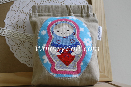 Matryoshka applique flex frame pouch