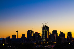 Profile of Calgary (Jim Boud) Tags: longexposure travel blue sunset sky canada mountains calgary tower yellow skyline architecture night skyscraper canon dark lens landscape eos gold lights hotel evening cityscape apartment nightshot crane dusk canadian observatory alberta northamerica layers dslr 1785mm digitalrebel photoart digitalslr province calgarytower artisticphotography 550d canonefs1785mm jimboud t2i jamesboud eos550d kissx4 skylineprofile