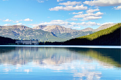 Lake Louise Lodge (Jim Boud) Tags: travel blue mountain lake canada mountains reflection green nature water pinetree clouds canon lens landscape outdoors eos hotel is nationalpark colorful paradise peace hill smooth relaxing rocky peaceful wideangle canadian lodge canoe shore alberta valley northamerica banff usm dslr lakelouise chateau 1785mm digitalrebel relaxed photoart digitalslr pinetrees efs1785mmf456isusm province firtree waterscape artisticphotography partlycloudy canadianrockies glacialvalley imagestabilization imagestabilized 550d jimboud t2i photomatixhdr exposurefusion jamesboud eos550d kissx4