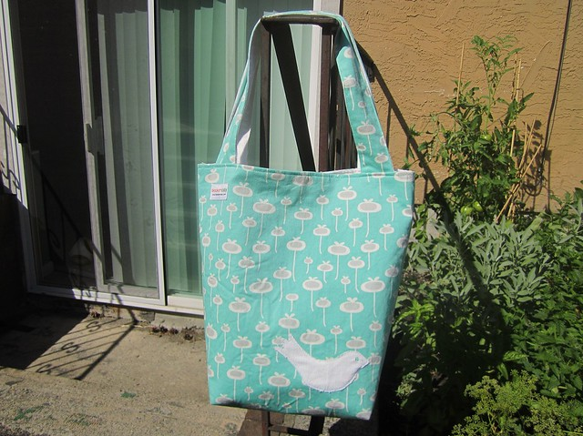 Free as a bird tote in sunlight