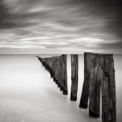Separated, Calais, France (Joel Tjintjelaar) Tags: france seascapes calais bwphotography groynes frenchcoast daytimelongexposure nd110 tjintjelaar bwnd110filter 10stopsdarkglass frenchseascapes zenandtheartofdaytimelongexposures