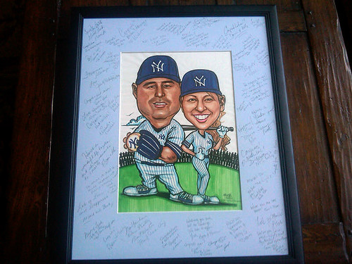 Yankees wedding couple caricatures with signatures in frame